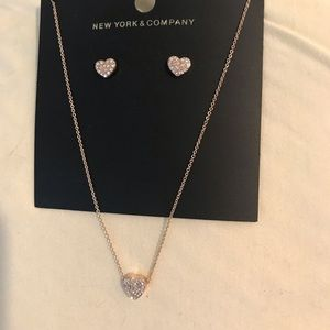 Gold tone heart necklace/earring set.